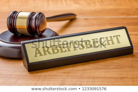 A gavel and a name plate with the engraving Labor Law Stock photo © Zerbor