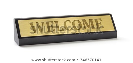 A name plate on a white background with the engraving Welcome Stock photo © Zerbor