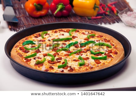 Delicious pizza pan with cheese crust  Stock photo © nalinratphi
