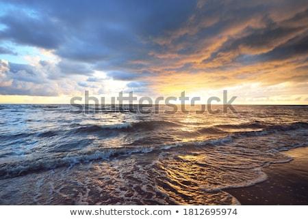zonsondergang · turkoois · water · oceaan · bewolkt - stockfoto © elenaphoto