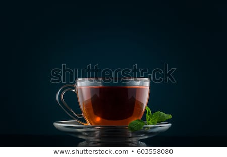 Cup of black tea on dark background Stock photo © ironstealth