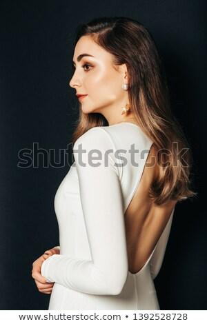 Belle tendre jeune femme robe noire ouvrir Retour Photo stock © deandrobot