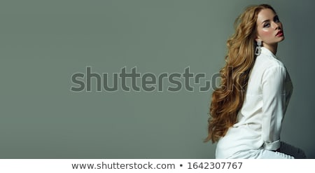 fashion photo of beautiful girl model with long wavy hair sittin Stock photo © Victoria_Andreas