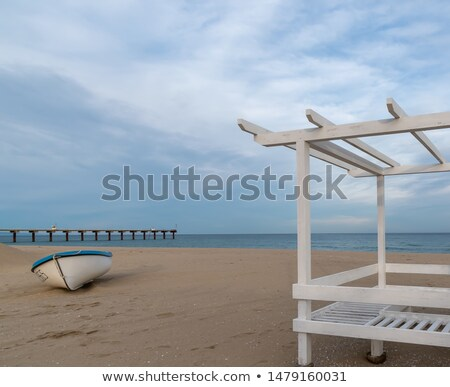 ストックフォト: Beach In The Morning With Beach Chairs And Fisher Boat