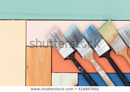 Neat arrangement of paintbrushes on stained wood Stock photo © ozgur