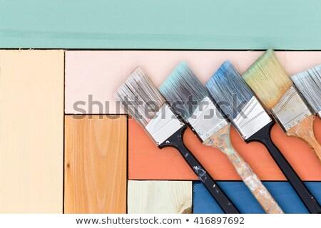 neat arrangement of paintbrushes on stained wood stock photo © ozgur