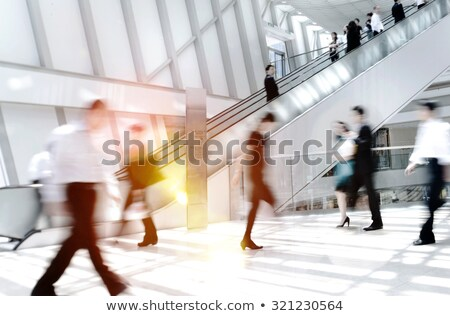 woman on a moving staircase in the shopping center stock photo © meinzahn