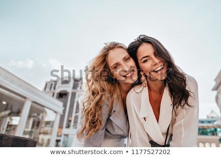 Fashion style photo of 2 young brunettes posing Stock photo © konradbak