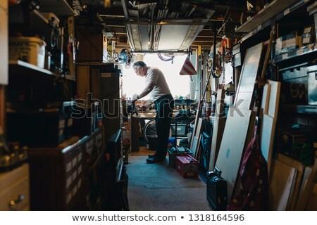 homem · trabalhando · martelo · condução · prego · branco - foto stock © Amaviael