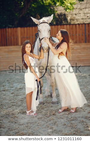 Zdjęcia stock: Two Romantic Female Models Posing With A Horse