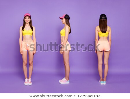 Back view of full length fitness woman Stock photo © deandrobot