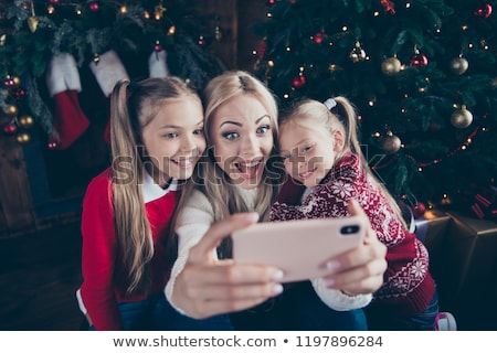 Mother and daughter make selfie Stock photo © deandrobot