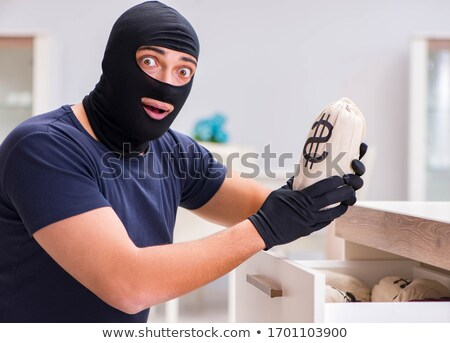 Stock photo: Robber wearing balaclava stealing valuable things