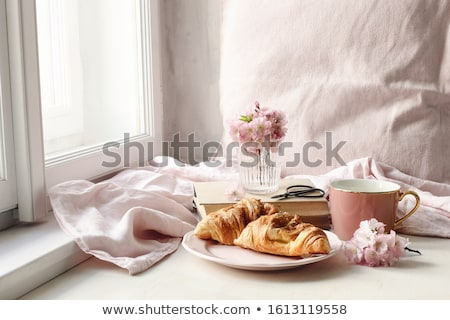 pastries croissants on table near cup of coffee stock photo © deandrobot