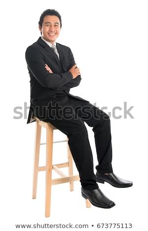 Egészalakos ázsiai üzletember ül magas szék Stock fotó © szefei