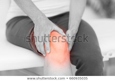 Középső rész férfi tart sebes térd fehér Stock fotó © wavebreak_media