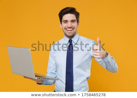 Portrait of a young businessman with thumb up  stock photo © gravityimaging