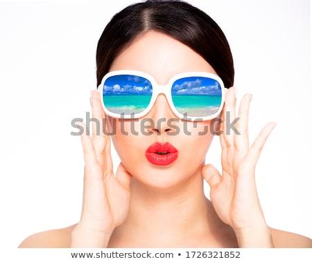 Asian woman in sunglasses Stock photo © LightFieldStudios
