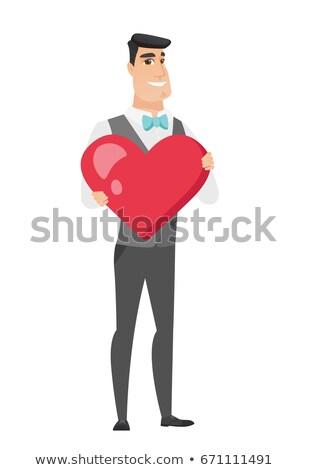 caucasian groom holding a big red heart stock photo © rastudio