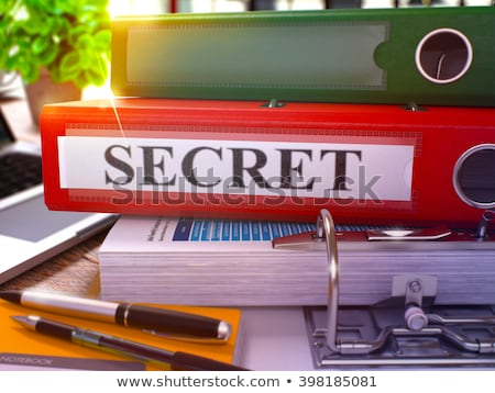 Secret on Red Ring Binder. Blurred, Toned Image. Stock photo © tashatuvango