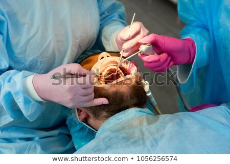 dentista · máscara · cirúrgica · dental · ferramentas · clínica - foto stock © is2