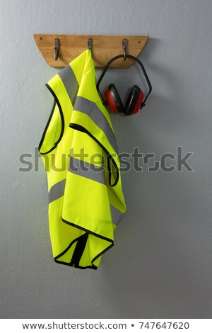 Protective workwear hanging on hook Stock photo © wavebreak_media