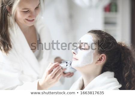 Kız 14 makyaj yatak genç Stok fotoğraf © IS2