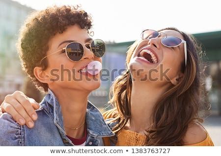 Fiatal lány szórakozás buborékfújás lány nevet boldogság Stock fotó © IS2