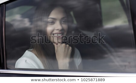 Stock photo: girls looking out of car windows