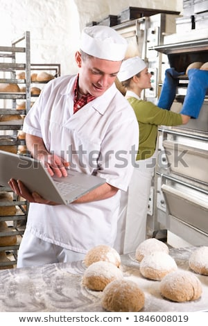 Three chefs looking at a laptop Stock photo © IS2