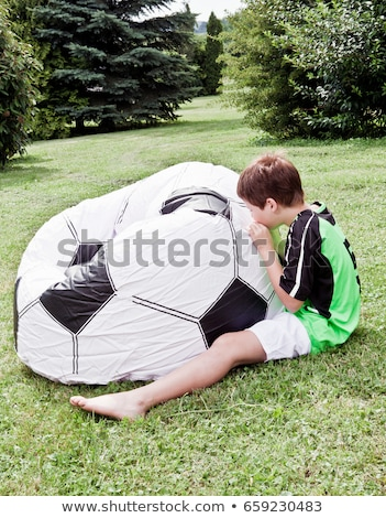 boy inflating giant football stock photo © is2