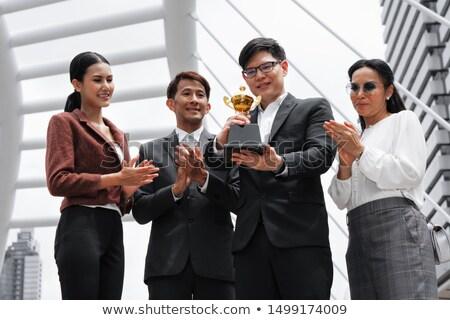 asian · zakenman · houden · gouden · gunning · beker - stockfoto © studioworkstock