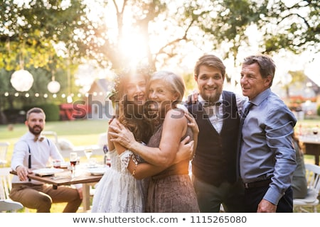 Bride and groom with parents smiling Stock photo © IS2