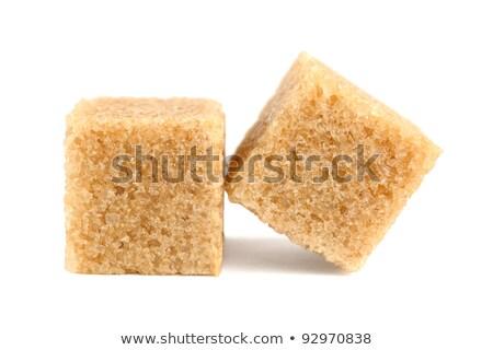 Azúcar moreno cubos aislado blanco superior vista Foto stock © ThreeArt