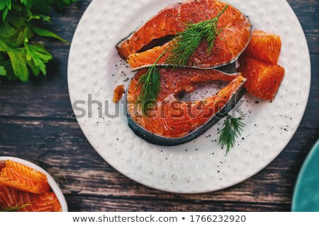 Preparation of trout, sliced lemon and green rosemary. Cooking food on wooden board Stock photo © FreeProd