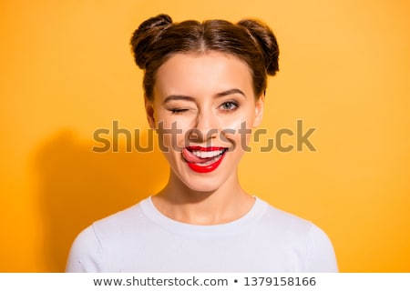 close up of woman with red lipstick licking lips Stock photo © dolgachov