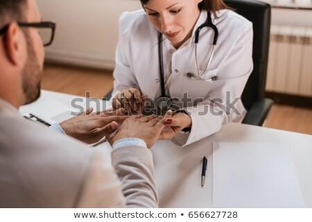 Orvos megvizsgál csukló közelkép női kéz Stock fotó © AndreyPopov