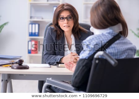 Injured employee visiting lawyer for advice on insurance Stock photo © Elnur