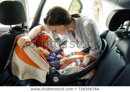 Stockfoto: Safe Driving Mother With Baby Children Car Trip