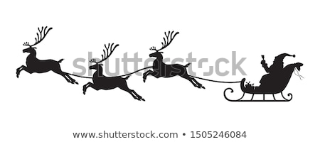santa and reindeer on the eve of christmas stock photo © liolle