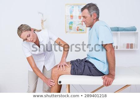medico · maschio · paziente · ginocchio · dolore - foto d'archivio © lopolo