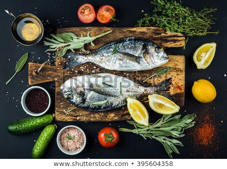 Raw uncooked sea fish with tomatoes and thyme Stock photo © artsvitlyna