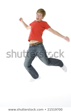 full length studio portrait of jumping teenage boy stock photo © monkey_business