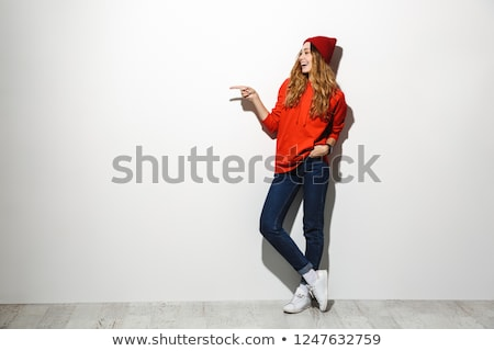 full length photo of content woman 20s wearing red clothes laugh stock photo © deandrobot