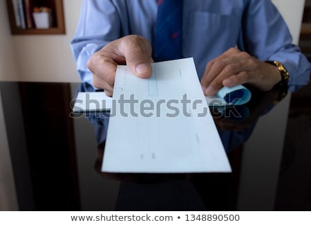 Man's Hands Giving Cheque To Other Person Stock photo © AndreyPopov