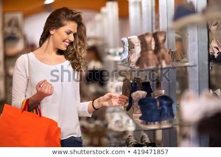 fashion girl shopping in shoe shop stock photo © smeagorl