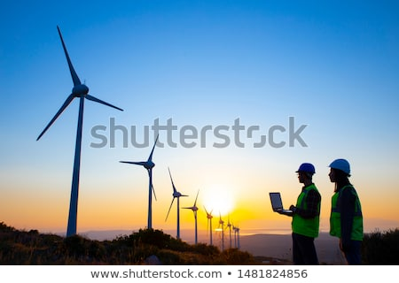 A Technician woman Engineer in Wind Turbine Power Generator Station Stock photo © Lopolo