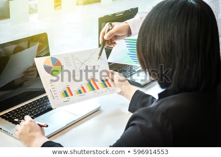 Two businessteam looking at report and having a discussion in of Stock photo © Freedomz