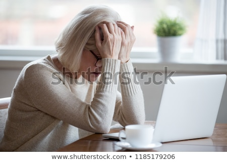 The middle-aged female employee suffering in the office  Stock photo © Elnur