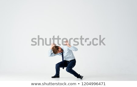 smiling young man pointing finger to his head Stock photo © dolgachov